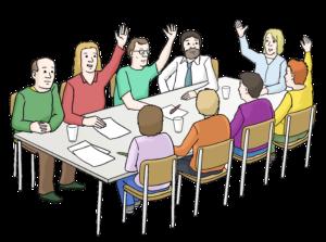 Bild zeigt neun Personen an einem Tisch, die abstimmen.