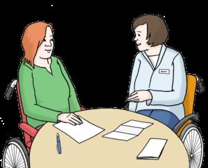 Bild zeigt zwei Personen an einem Tisch in einem Beratungsgespräch.
